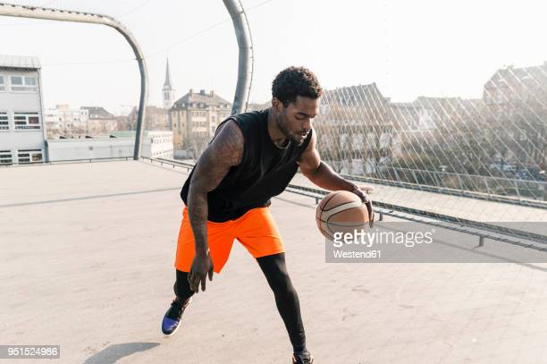 basketball player in action on court - dribbling sports stock pictures, royalty-free photos & images