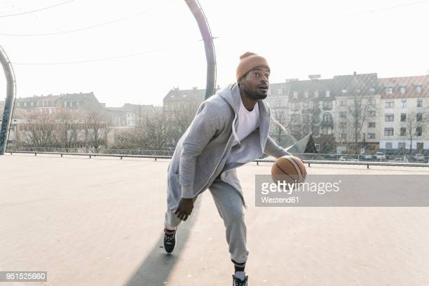 basketball player in action on court - jogging pants stock pictures, royalty-free photos & images