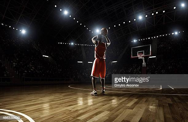 basketball player in action - basketball stadium stock photos and pictures