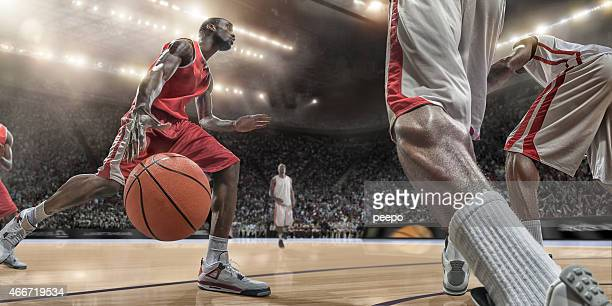 basketball-spieler in aktion - basketball stock-fotos und bilder