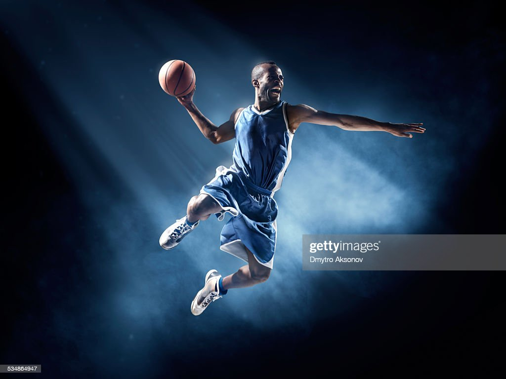 Basketball player in jump shot : Stock Photo