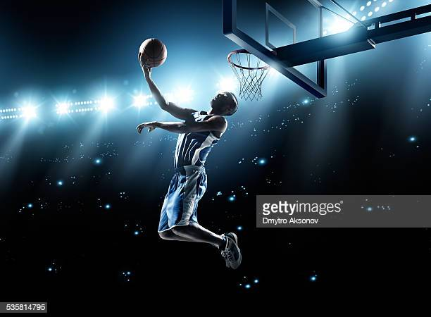 basketball player in jump shot - leisure games stock pictures, royalty-free photos & images