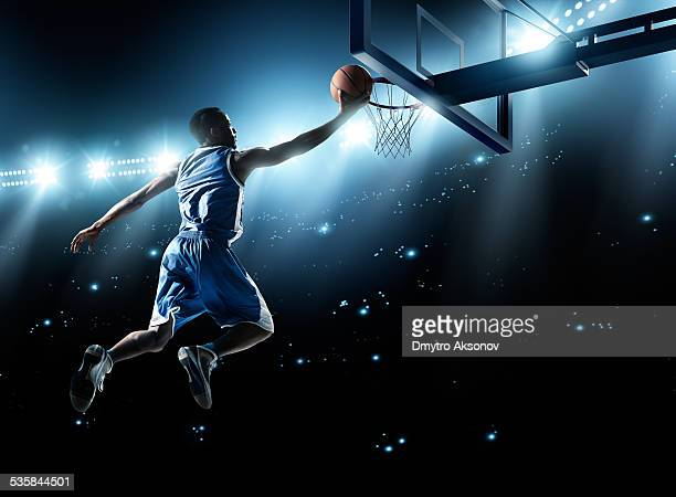 basketball player in jump shot - shooting baskets stock photos and pictures