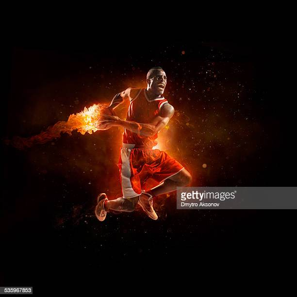 Basketball player in jump shot with fireball
