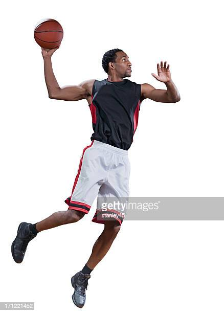 basketball player in mid-air doing a jump shot - basketball player stock pictures, royalty-free photos & images