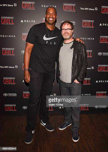Basketball player Jason Collins and actor Rainn Wilson attend the Fast Company Grill During SXSW Day 2 on March 15 2015 in Austin Texas
