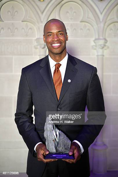 """Basketball player Jason Collins poses backstage with his Trailblazers honour award during Logo TV's """"Trailblazers"""" at the Cathedral of St. John the..."""