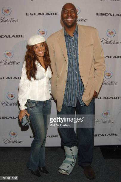 Basketball player John Salley and wife Natasha arrive for the Chrome Couture 2007 Escalade Preview Party on November 09 2005 in Los Angeles California