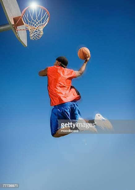 Basketball Player Jumping to Hoop