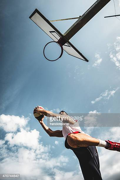 basketball player jumping to score - making a basket scoring stock pictures, royalty-free photos & images