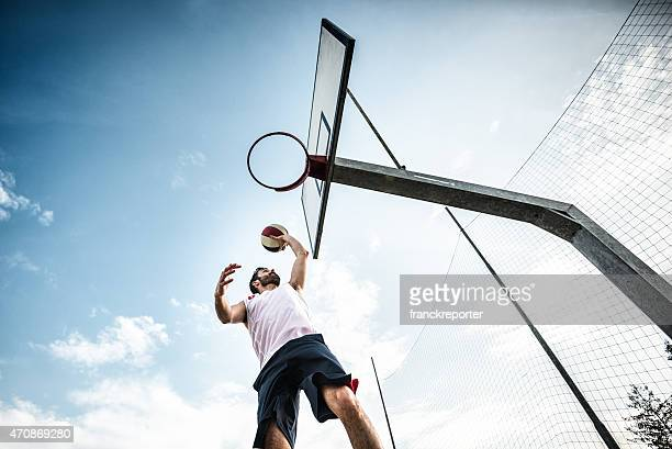 basketball player jumping to score - making a basket scoring stock photos and pictures
