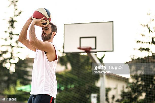 basketball player jumping to score