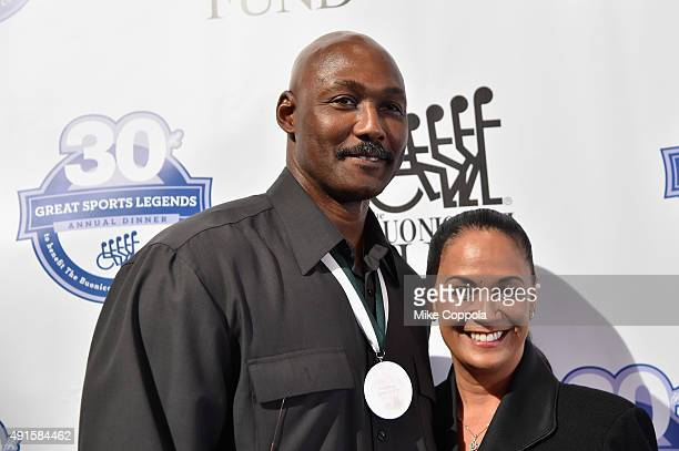Basketball player Karl Malone and his wife Kay Kinsey Malone attend the 30th Annual Great Sports Legends Dinner to benefit The Buoniconti Fund to...
