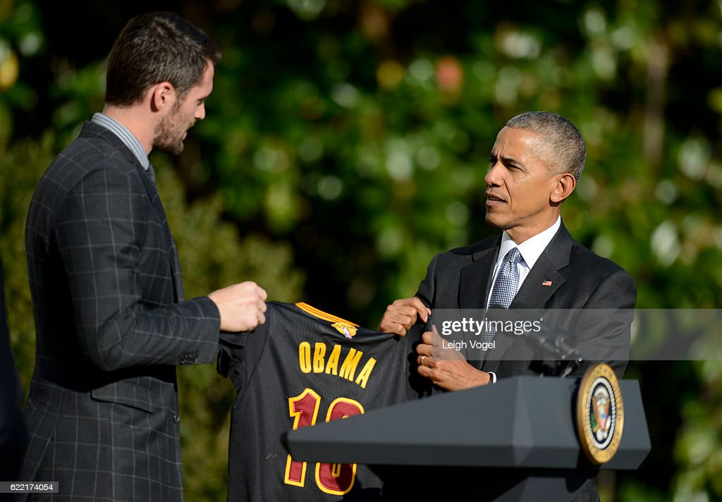 Basketball player Kevin Love presents President Obama with a jersey after welcoming the 2016 NBA Champions Cleveland Cavaliers to The White House on November 10, 2016 in Washington, DC.