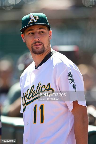 Basketball player Klay Thompson of the Golden State Warriors stands on the field before the game between the Oakland Athletics and the San Francisco...
