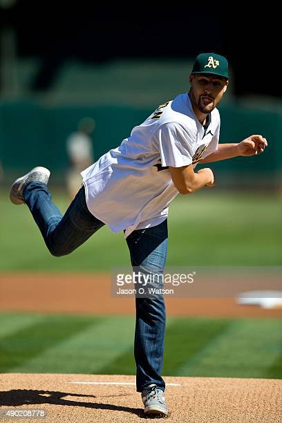 Basketball player Klay Thompson of the Golden State Warriors throws out a ceremonial first pitch before the game between the Oakland Athletics and...