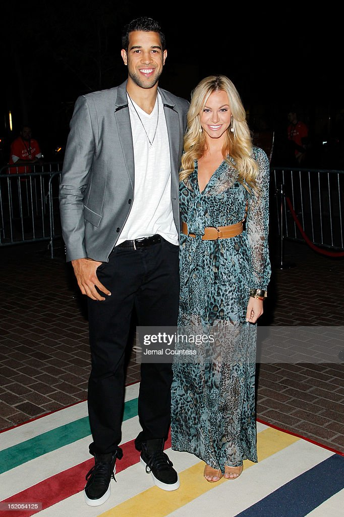 Basketball player Landry Fields (L) of the Toronto Raptors and Elaine Alden attend the 'Bad 25' Premiere during the 2012 Toronto International Film Festival held at the Ryerson Theatre on September 15, 2012 in Toronto, Canada.