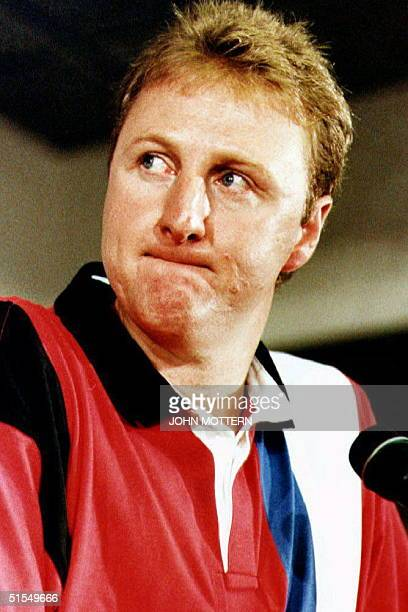Basketball player Larry Bird of the Boston Celtics announces his retirement from professional basketball at a press conference at the Boston Garden...