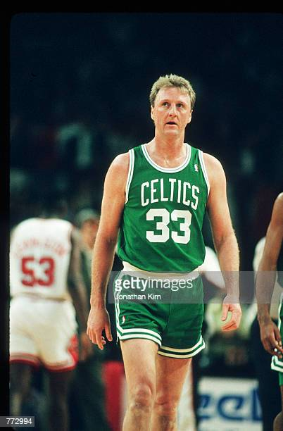 Basketball player Larry Bird stands during a basketball game February 15 1991 in Chicago IL Bird played for the Boston Celtics helped them to win...