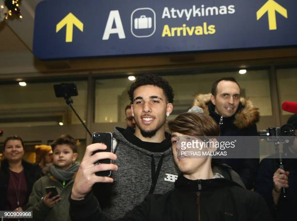 US basketball player LiAngelo Ball poses with fans upon his arrival at Vilnius airport in Lithuania on January 3 as he and his brother are about to...