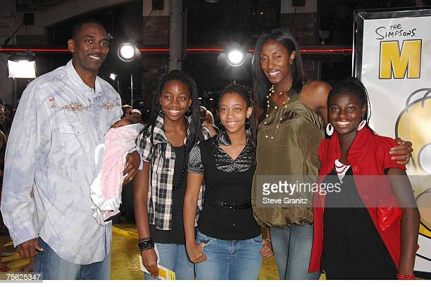 Basketball player Lisa Leslie husband Michael Lockwood and daughter Lauren arrives at The Simpsons Movie premiere at the Mann Village Theatre on July...