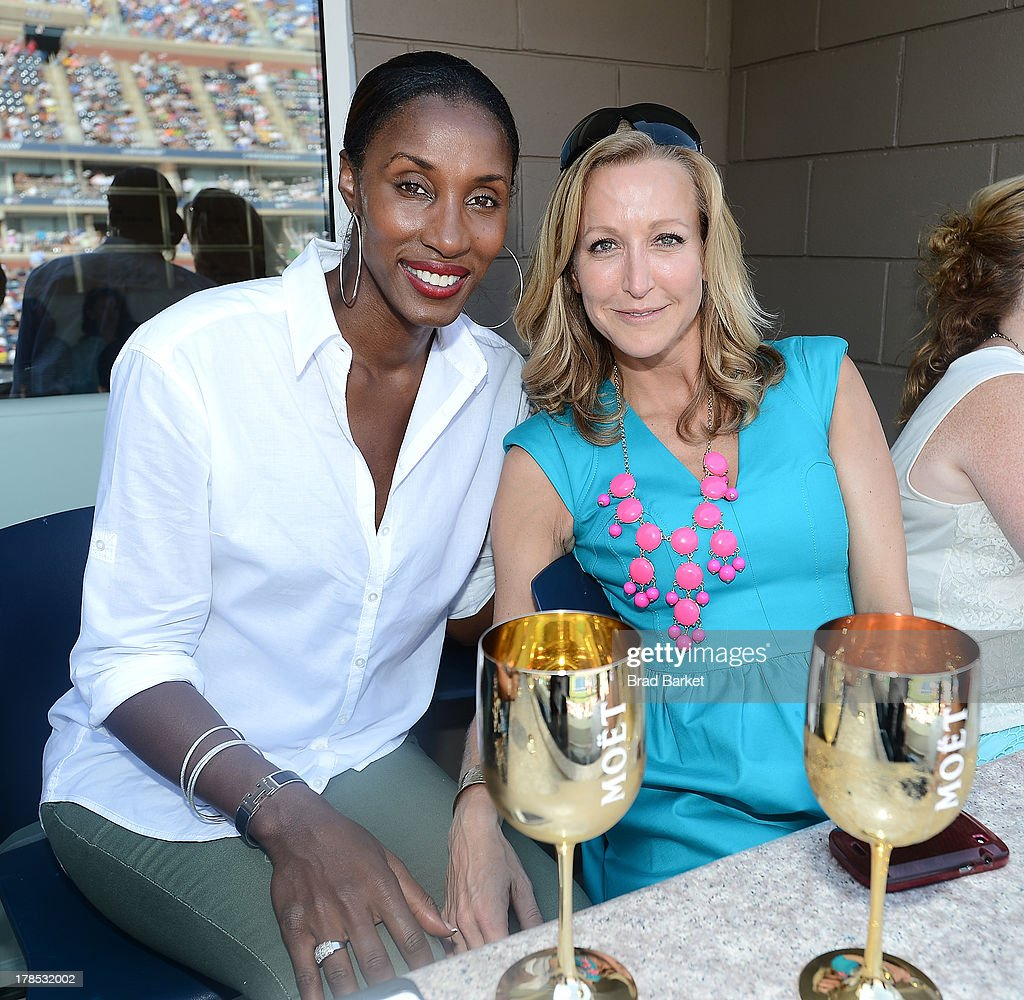 Basketball player Lisa Leslie-Lockwood (L) and Lara Spencer attend The Moet & Chandon Suite at USTA Billie Jean King National Tennis Center on August 29, 2013 in New York City.