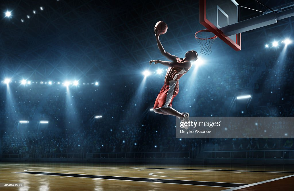 Basketball player makes slam dunk : Stock Photo