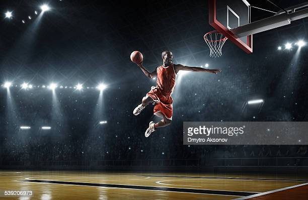 basketball player makes slam dunk - taking a shot sport stock pictures, royalty-free photos & images