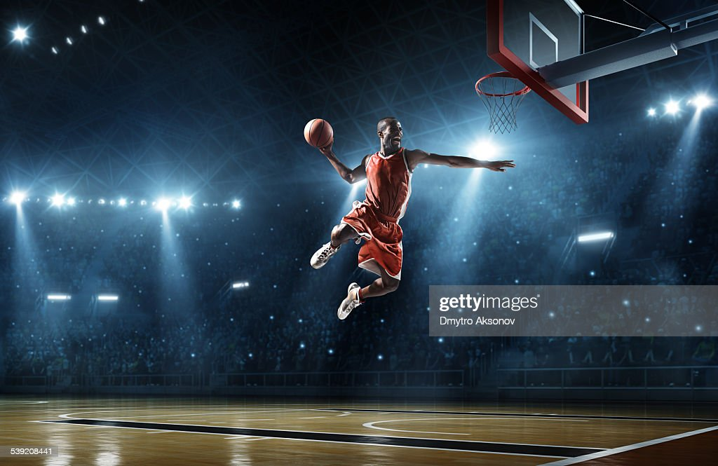 Basketball player makes slam dunk : Stock Photo