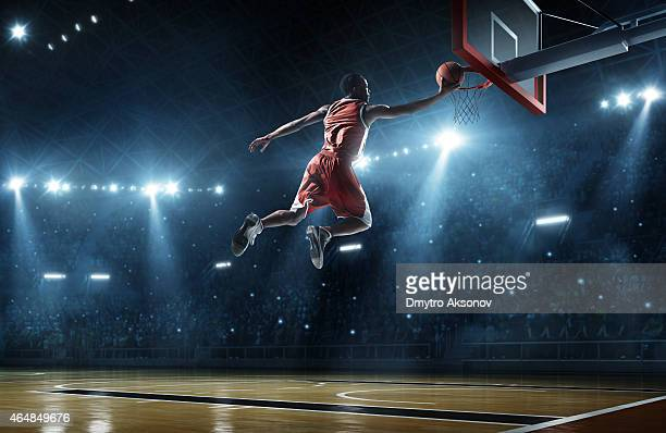 Basketball player making a slam dunk with fans watching