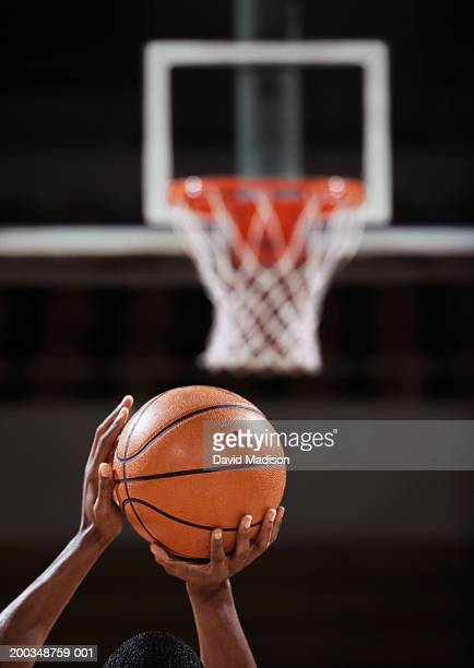 basketball player making free throw, rear view, close-up of hands - tiro libre encestar fotografías e imágenes de stock