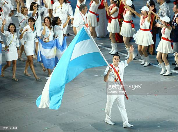 Basketball player Manu Ginobili of Argentina carries his country's flag during the Opening Ceremony for the 2008 Beijing Summer Olympics at the...
