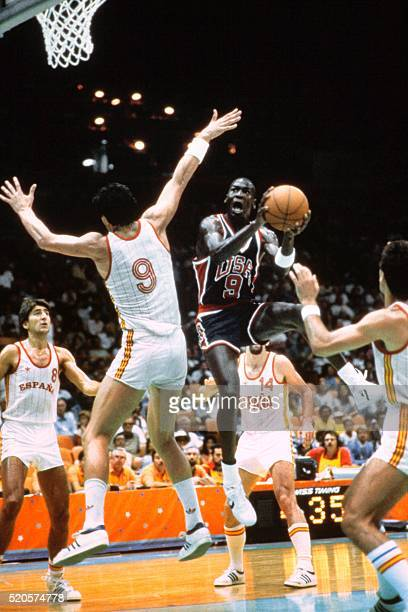 US basketball player Michael Jordan is about to shoot during a match against Spain at Los Angeles on April 04 1984 during the Olympic Games in Los...