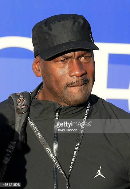 Basketball player Michael Jordan of the United States watches during the Morning Fourballs of the 2014 Ryder Cup on the PGA Centenary course at the...