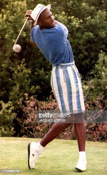 US basketball player Michael Jordan swings a golf club at the MonteCarlo Golf Club 22 July 1992 Jordan will participate in the 25th Olympic Games in...