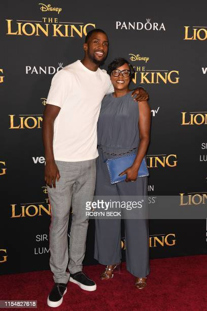 "Basketball player Michael Kidd-Gilchrist and Cindy Richardson arrive for the world premiere of Disney's ""The Lion King"" at the Dolby theatre on July..."