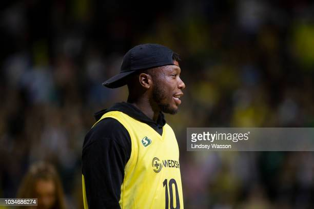 Basketball player Nate Robinson a Seattle native is recognized by the crowd during a time out in Game 2 of the WNBA Finals at KeyArena on September 9...