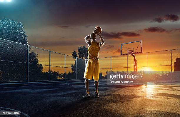 Basketball player on outdoor streetball playground