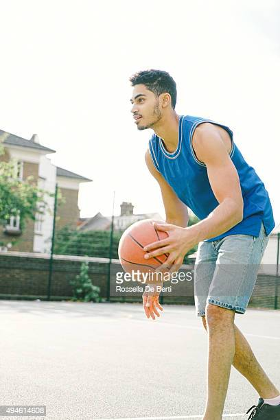 basketball player on the court, bouncing - fulham stock pictures, royalty-free photos & images