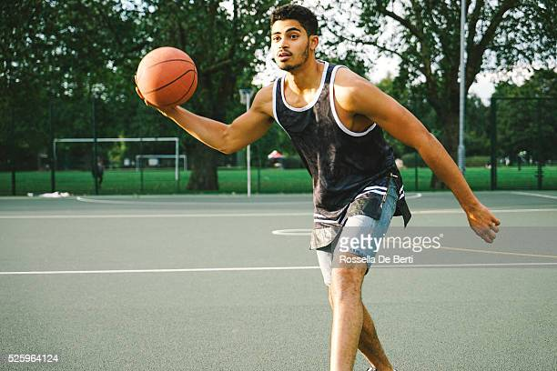Basketball Player On The Court Facing Opponents