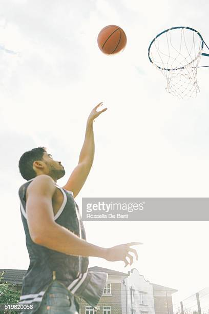 Basketball Player On The Court, Slam Dunking Ball