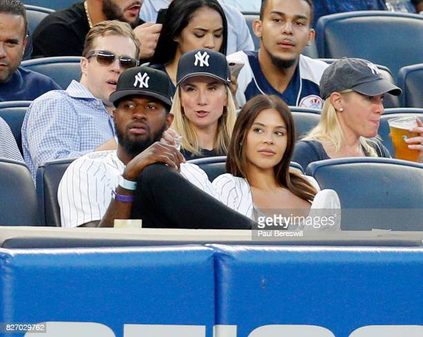 NBA basketball player Paul George of the Oklahoma City Thunder and Daniela Rajic watch an MLB baseball game between the Detroit Tigers and the New...