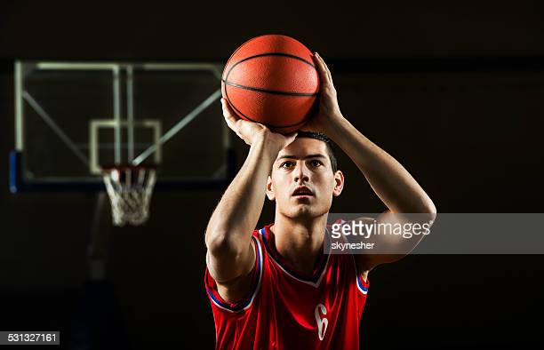 basketball player. - shooting baskets stock photos and pictures