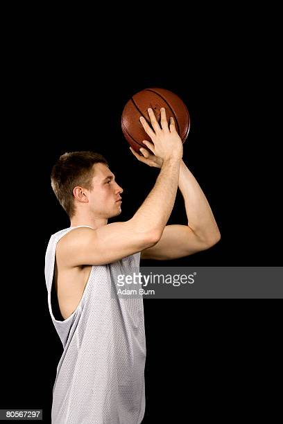 a basketball player - shooting baskets stock pictures, royalty-free photos & images