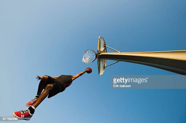 basketball player - slam dunk stock pictures, royalty-free photos & images