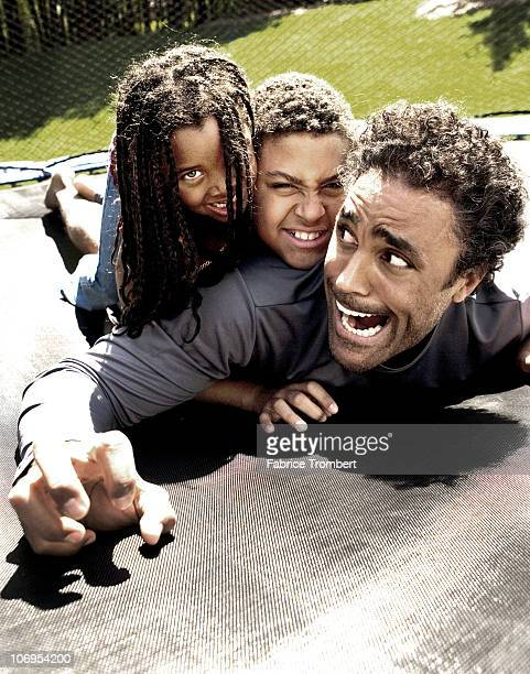 Basketball Player Rick Fox with son Kyle and daughter Sasha is photographed for Essence Magazine