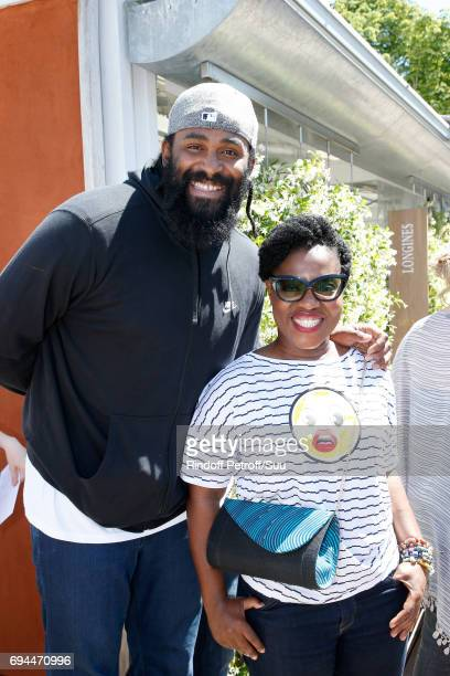 Basket-Ball player Ronny Turiaf and humorist Claudia Tagbo attend the Women Final of the 2017 French Tennis Open - Day Fourteen at Roland Garros on...