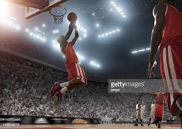 basketball player scores during game - leisure games stock pictures, royalty-free photos & images