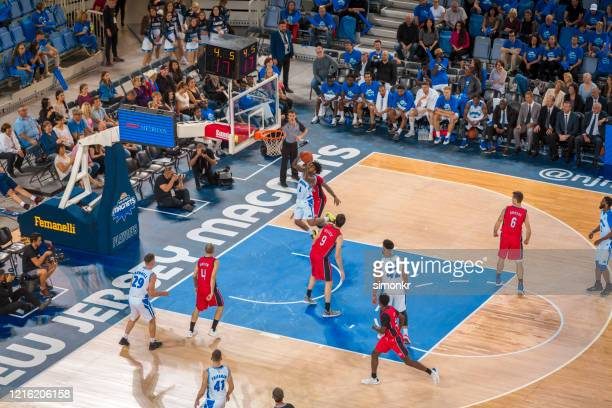 basketball player scoring slam dunk - nba stock pictures, royalty-free photos & images