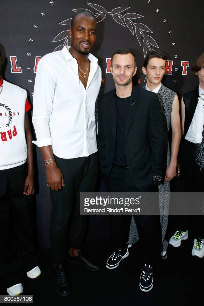 BasketBall player Serge Ibaka and Stylist Kris Van Assche pose Backstage after the Dior Homme Menswear Spring/Summer 2018 show as part of Paris...